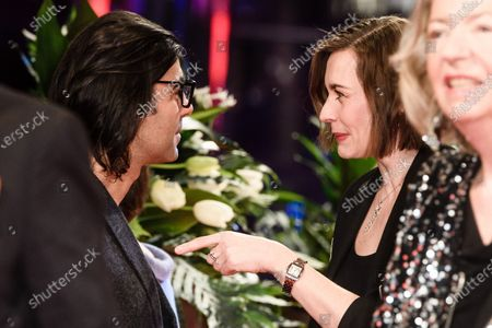 Christiane Paul (C-R) and German director Fatih Akin (C-L) talk as they arrive for the Opening Ceremony of the 70th annual Berlin International Film Festival (Berlinale), in Berlin, Germany, 20 February 2020. The Berlinale runs from 20 February to 01 March 2020.