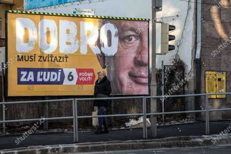 A woman walks past an election poster of leader of For the people (Za ludi) party, former Slovak president Andrej Kiska, in Bratislava, Slovakia, 20 February 2020. Slovakia will be holding parliamentary elections on 29 February 2020. The slogan reads: 'The good must win'.