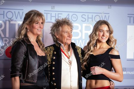 Stock Picture of Rod Stewart, Penny Lancaster, Ruby Stewart. Rod Stewart, Penny Lancaster and Ruby Stewart pose for photographers upon arrival at Brit Awards 2020 in London