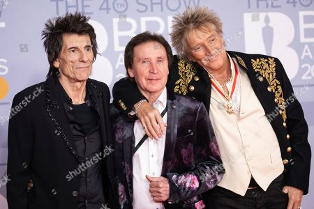 Ronnie Wood, Kenney Jones, Rod Stewart. From left, Ronnie Wood, Kenney Jones and Rod Stewart pose for photographers upon arrival at Brit Awards 2020 in London