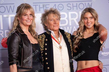 Rod Stewart, Penny Lancaster, Ruby Stewart. Rod Stewart, Penny Lancaster and Ruby Stewart pose for photographers upon arrival at Brit Awards 2020 in London