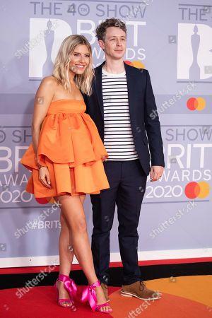Mollie King, Matt Edmondson. Mollie King and Matt Edmondson pose for photographers upon arrival at Brit Awards 2020 in London