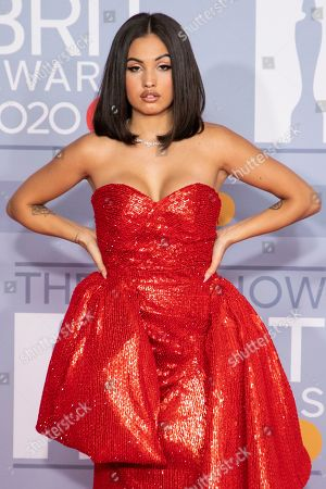 Stock Image of Mabel McVey poses for photographers upon arrival at Brit Awards 2020 in London