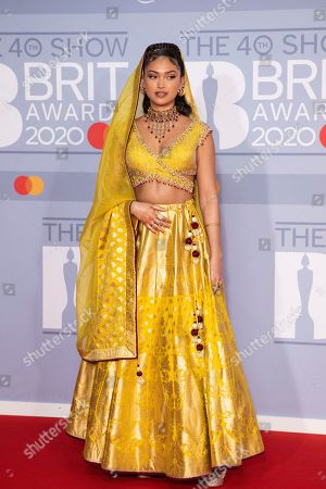Joy Crookes poses for photographers upon arrival at Brit Awards 2020 in London