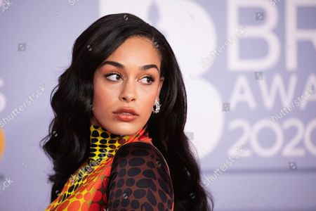 Jorja Smith poses for photographers upon arrival at Brit Awards 2020 in London