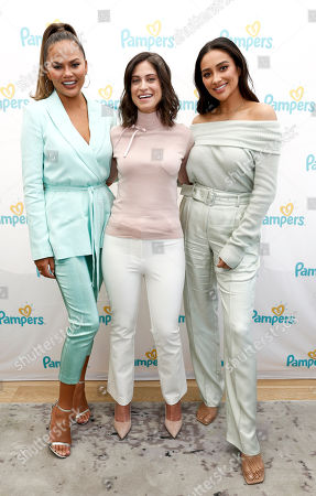 """Stock Image of Chrissy Teigen, Dr. Alexandra Sacks, M.D., Shay Mitchell. From left, Chrissy Teigen, Dr. Alexandra Sacks, M.D. and Shay Mitchell join Pampers to help uplift moms through """"Share the Love"""" ? a movement to inspire and remind moms they are doing great,, in New York"""
