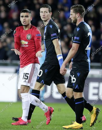 Andreas Pereira of Manchester United (L) reacts with Mats Rits of Brugge (R) during the UEFA Europa League Round of 32, 1st leg match between Club Brugge and Manchester United in Bruges, Belgium, 20 February 2020.