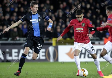 Hans Vanaken of Brugge (L) in action against Andreas Pereira of Manchester United (2-R) during the UEFA Europa League Round of 32, 1st leg match between Club Brugge and Manchester United in Bruges, Belgium, 20 February 2020.