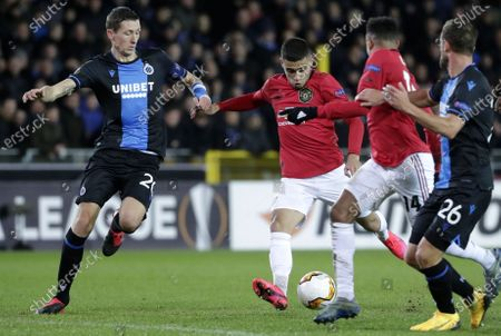 Hans Vanaken of Brugge (L) in action against Andreas Pereira of Manchester United (2-L) during the UEFA Europa League Round of 32, 1st leg match between Club Brugge and Manchester United in Bruges, Belgium, 20 February 2020.