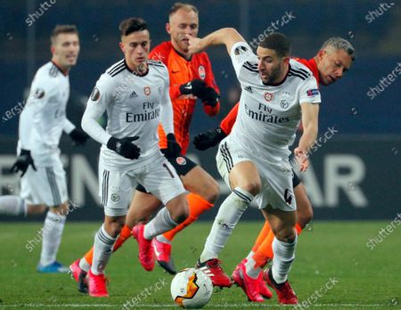 Adel Taarabt (R-front) of Benfica and Marlos (R-rear) of Shakhtar in action during the UEFA Europa League round of 32, first leg, soccer match between FC Shakhtar Donetsk and SL Benfica in Kharkiv, Ukraine, 20 February 2020.