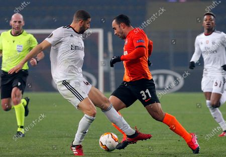 Ismaily (R) of Shakhtar and Adel Taarabt (L) of Benfica in action during the UEFA Europa League round of 32, first leg, soccer match between FC Shakhtar Donetsk and SL Benfica in Kharkiv, Ukraine, 20 February 2020.