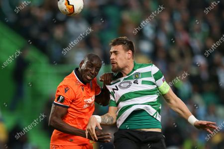 Sporting CP Sebastian Coates (R) fights for the ball with Istanbul Basaksehir Demba Ba (L) during the UEFA Europa League round of 32, 1st leg soccer match at Alvalade Stadium in Lisbon, Portugal, 20 February 2020.