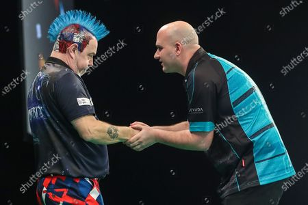Peter Wright and Rob Cross at the end of their match during the Unibet Premier League darts at Motorpoint Arena, Cardiff