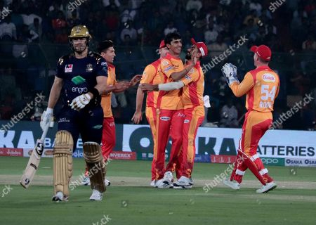 Islamabad United players celebrate the dismissal of Shane Watson of Quetta Gladiators during the Super League opening match at National Stadium in Karachi, Pakistan