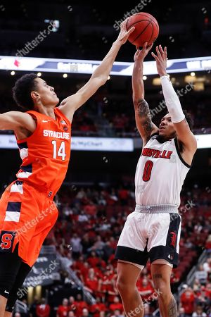 Louisville guard Lamarr Kimble (0) has his shot blocked by Syracuse center Jesse Edwards (14) during the second half of an NCAA college basketball game, in Louisville, Ky. Louisville won 90-66