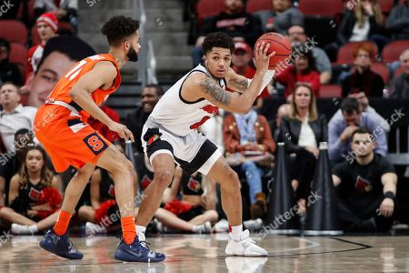 Louisville guard Lamarr Kimble (0) is pressured by Syracuse guard Howard Washington (10) during the second half of an NCAA college basketball game, in Louisville, Ky. Louisville won 90-66