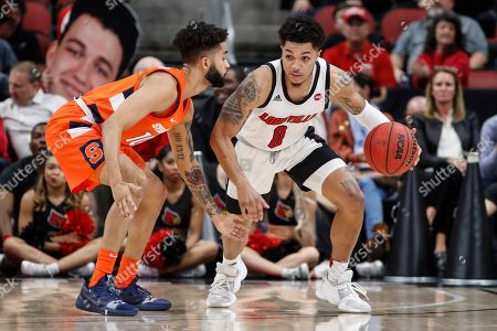 Louisville guard Lamarr Kimble (0) drives the ball up court as he's pressured by Syracuse guard Howard Washington (10) during the second half of an NCAA college basketball game, in Louisville, Ky. Louisville won 90-66