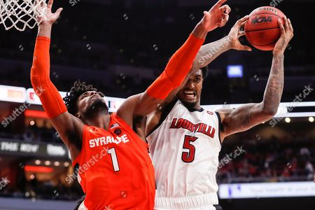 Louisville forward Malik Williams (5) grabs a rebound from Syracuse forward Quincy Guerrier (1) during the second half of an NCAA college basketball game, in Louisville, Ky. Louisville won 90-66