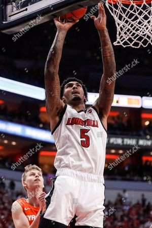 Louisville forward Malik Williams (5) shoots during the second half of an NCAA college basketball game against Syracuse, in Louisville, Ky. Louisville won 90-66