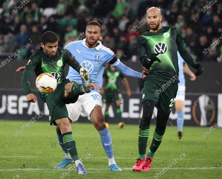 Wolfsburg's Paulo Otavio (L) and Wolfsburg's John Anthony Brooks (R) in action against Malmoe's Isaac Kiese Thelin (C) during the UEFA Europa League round of 32, first leg soccer match between VfL Wolfsburg and Malmoe FF in Wolfsburg, Germany, 20 February 2020.