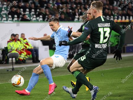 Stock Image of Malmoe's Jonas Knudsen  (L) in action against Wolfsburg's Yannick Gerhardt (R) during the UEFA Europa League round of 32, first leg soccer match between VfL Wolfsburg and Malmoe FF in Wolfsburg, Germany, 20 February 2020.