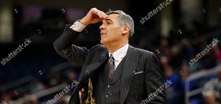 Villanova head coach Jay Wright watches his team play DePaul during an NCAA college basketball game, in Chicago. Villanova won the game 91-71