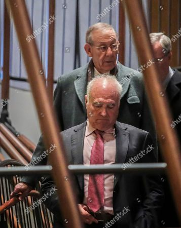 Miami Dolphins owner Stephen Ross, top center, and Miami Dolphins Jeffrey Lurie, front center, leave after NFL owners meet to discuss a proposed labor agreement, in New York