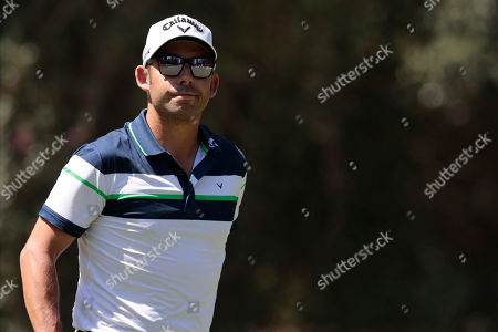 Pablo Larrazabal of Spain reacts after missing a putt during the first round of the WGC-Mexico Championship golf tournament, at Chapultepec Golf Club in Mexico City, Mexico City