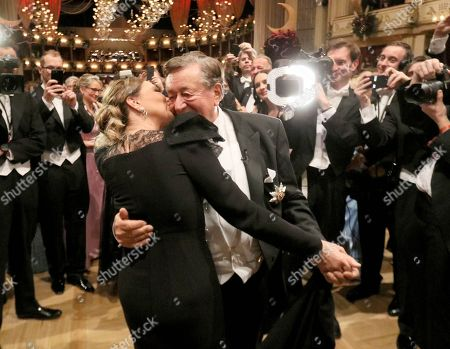 Ornella Muti, Richard Lugner. Italian actress Ornella Muti kisses Austrian businessman Richard Lugner, from left, on the dance floor during traditional Opera Ball in Vienna, Austria