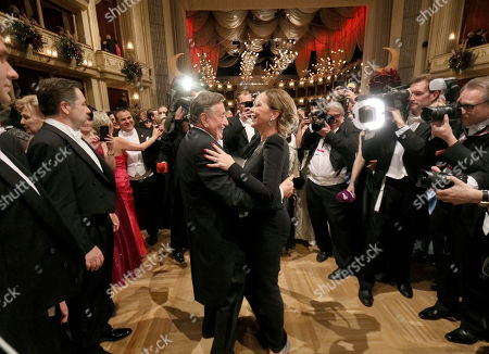 Richard Lugner, Ornella Muti. Austrian businessman Richard Lugner, center, dances with Italian actress Ornella Muti, on the dance floor during the traditional Opera Ball in Vienna, Austria