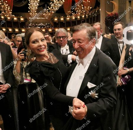 Richard Lugner, Ornella Muti. Austrian businessman Richard Lugner, right, dances with Italian actress Ornella Muti on the dance floor during the traditional Opera Ball in Vienna, Austria