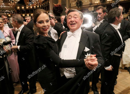 Ornella Muti, Richard Lugner. Austrian businessman Richard Lugner, right, dances with Italian actress Ornella Muti on the dance floor during the traditional Opera Ball in Vienna, Austria