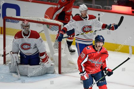 Washington Capitals center Lars Eller (20), of Denmark, celebrates his goal against Montreal Canadiens goaltender Carey Price, top left, and defenseman Brett Kulak (77) during the second period of an NHL hockey game, in Washington