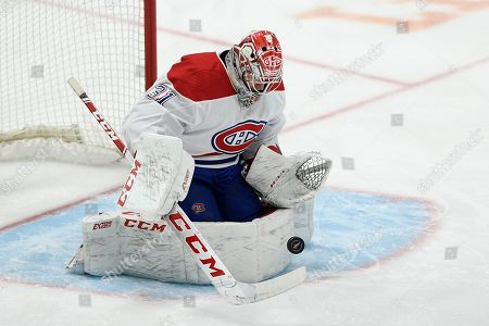 Montreal Canadiens goaltender Carey Price (31) stops the puck during the first period of an NHL hockey game against the Washington Capitals, in Washington. The Canadiens won 4-3 in overtime