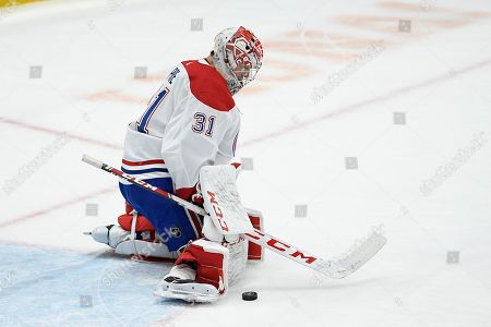 Montreal Canadiens goaltender Carey Price (31) follows the puck during the first period of an NHL hockey game against the Washington Capitals, in Washington