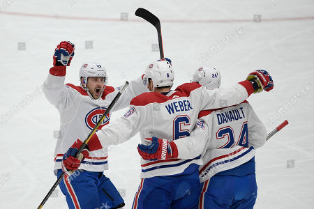 Montreal Canadiens defenseman Shea Weber (6) celebrates his goal with center Phillip Danault (24) and left wing Tomas Tatar (90) during the first period of an NHL hockey game against the Washington Capitals, in Washington
