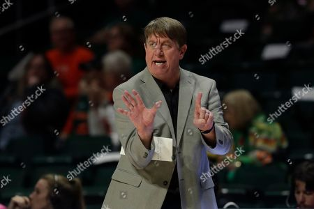 Stock Photo of North Carolina State head coach Wes Moore calls a play during the second half of an NCAA college basketball game against Miami, in Coral Gables, Fla