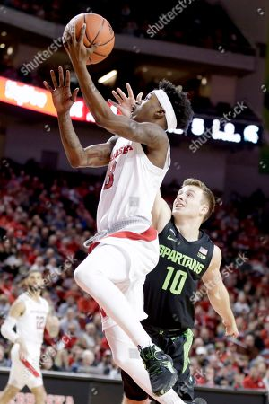 Nebraska's Cam Mack (3) goes for a layup past Michigan State's Jack Hoiberg (10) during the first half of an NCAA college basketball game in Lincoln, Neb