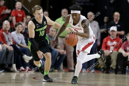 Nebraska's Cam Mack (3) drives past Michigan State's Jack Hoiberg (10) during the first half of an NCAA college basketball game in Lincoln, Neb