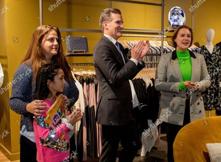 Jeff Gennette, Macy's chairman and CEO, center, joins Macy's brand experience officer Rachel Shechtman, left, and Mayor of Southlake Laura Hill, at the VIP grand opening celebration of Macy's new store format, Market by Macy's, in Southlake, Texas