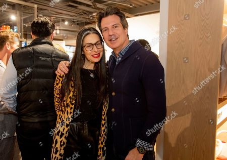 Stock Image of Stylist and TV personality Stacy London poses with Adam Glassman, Creative Director of O, Oprah The Magazine, at the VIP grand opening celebration of Macy's new store format, Market by Macy's, in Southlake, Texas