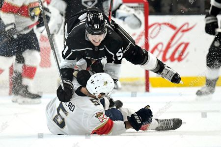 Los Angeles Kings left wing Austin Wagner, top, collides with Florida Panthers defenseman Aaron Ekblad during the second period of an NHL hockey game, in Los Angeles