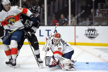 Florida Panthers goaltender Sergei Bobrovsky, right, is cored on by Los Angeles Kings center Trevor Moore, center, as defenseman Josh Brown defends during the second period of an NHL hockey game, in Los Angeles