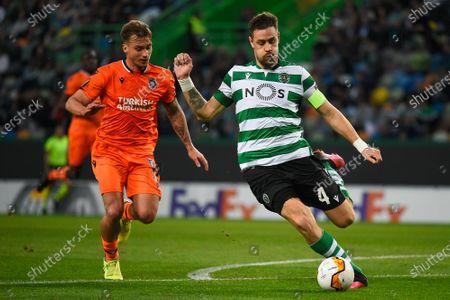 Sebastian Coates of Sporting Lisbon and Enzo Crivelli of Istanbul Basaksehir