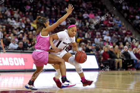 Zia Cooke, Jaelyn Richard-Harris. South Carolina's Zia Cooke (1) dribbles while defended by LSU's Jaelyn Richard-Harris during the first half of an NCAA college basketball game, in Columbia, S.C. South Carolina won 63-48