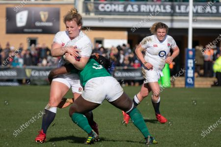 Vicky Fleetwood of England WRU tackled by Linda Djougang of Ireland WRU
