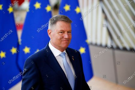 Romania's Prime Minister Klaus Werner Iohannis speaks to media as he arrives at the second day of a Special European Council summit in Brussels, Belgium, 21 February 2020. EU heads of state or government gather for a special meeting to discuss the EU's long-term budget for 2021-2027.