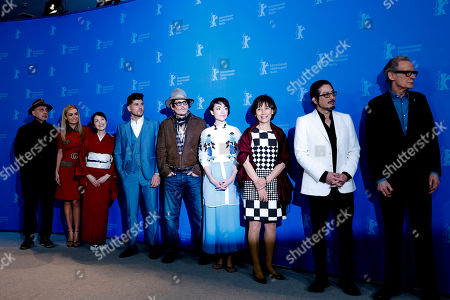 From left: Cinematographer Benoit Delhomme, actresses Katherine Jenkins, Akiko Iwase, director Andrew Levitas, actor Johnny Depp, actress Minami, writer Aileen Mioko Smith, actor Hiroyuki Sanada and actor Bill Nighy pose during a photo-call for the film Minamata during the 70th International Film Festival Berlin, Berlinale in Berlin, Germany