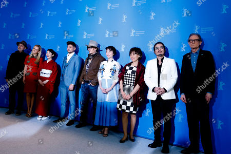 Stock Photo of From left: Cinematographer Benoit Delhomme, actresses Katherine Jenkins, Akiko Iwase, director Andrew Levitas, actor Johnny Depp, actress Minami, writer Aileen Mioko Smith, actor Hiroyuki Sanada and actor Bill Nighy pose during a photo-call for the film Minamata during the 70th International Film Festival Berlin, Berlinale in Berlin, Germany
