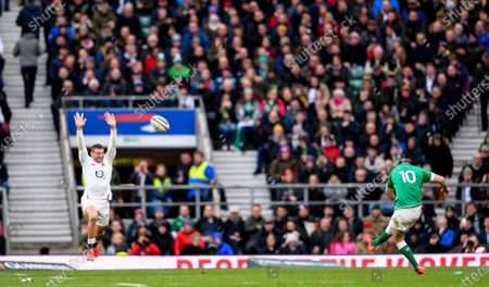 23rd February 2020; Twickenham, London, England; International Rugby, Six Nations Rugby, England versus Ireland; Jonathan Sexton of Ireland attempts a conversion while Jonny May of England tries to charge it down